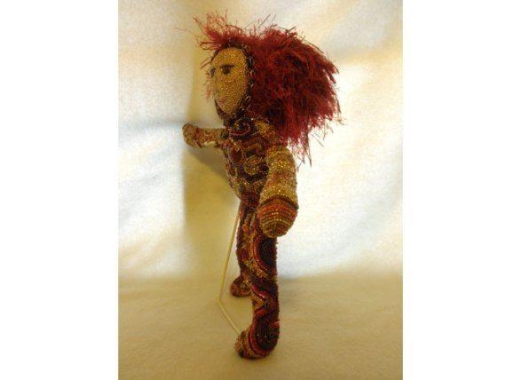 кукла из бисера.