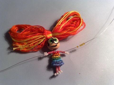 Плетеная бисером кукла почти